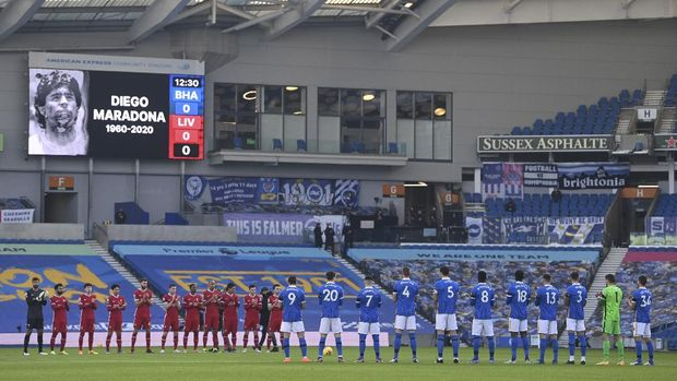 Birghton and Liverpool players pay their respect to soccer Legend Diego Maradona prior to the start of the English Premier League soccer match between Brighton and Hove Albion and Liverpool at the Amex stadium in Brighton, England, Saturday, Nov. 28, 2020. (Neil Hall/Pool Via AP)