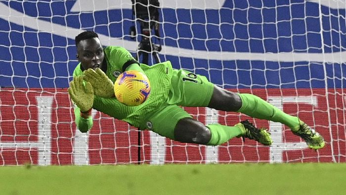 Chelseas goalkeeper Edouard Mendy saves a shot during the English Premier League soccer match between Chelsea and Tottenham Hotspur at Stamford Bridge in London, England, Sunday, Nov. 29, 2020. (Justin Tallis/Pool via AP)