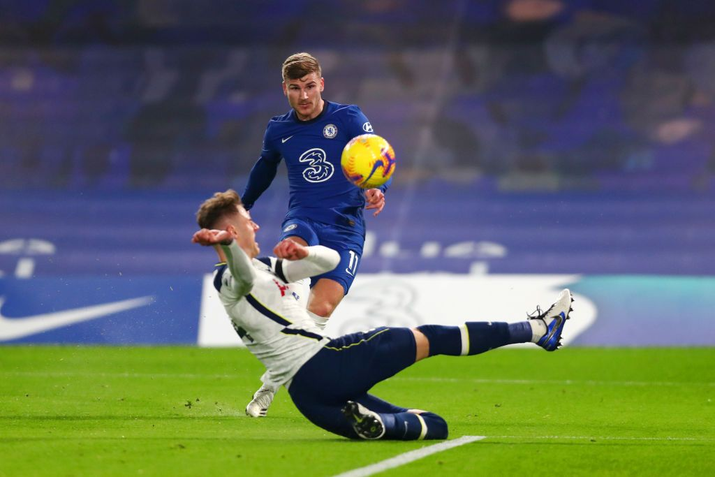 LONDON, ENGLAND - NOVEMBER 29: Timo Werner of Chelsea has a goal disallowed for offside as Joe Rodon of Tottenham Hotspur slides in during the Premier League match between Chelsea and Tottenham Hotspur at Stamford Bridge on November 29, 2020 in London, England. Sporting stadiums around the UK remain under strict restrictions due to the Coronavirus Pandemic as Government social distancing laws prohibit fans inside venues resulting in games being played behind closed doors. (Photo by Clive Rose/Getty Images)