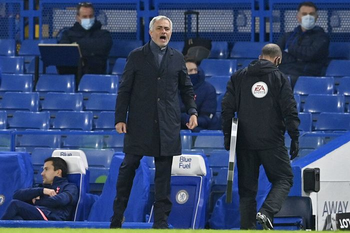 Tottenhams manager Jose Mourinho stands by the touchline during the English Premier League soccer match between Chelsea and Tottenham Hotspur at Stamford Bridge in London, England, Sunday, Nov. 29, 2020. (Justin Tallis/Pool via AP)