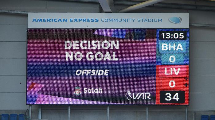 BRIGHTON, ENGLAND - NOVEMBER 28: The big screen shows the VAR decision to disallow Liverpools first goal during the Premier League match between Brighton & Hove Albion and Liverpool at American Express Community Stadium on November 28, 2020 in Brighton, England. Sporting stadiums around the UK remain under strict restrictions due to the Coronavirus Pandemic as Government social distancing laws prohibit fans inside venues resulting in games being played behind closed doors. (Photo by Mike Hewitt/Getty Images)