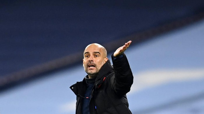 Manchester Citys head coach Pep Guardiola gives instructions to his players during the English Premier League soccer match between Manchester City and Burnley at the Etihad stadium in Manchester, England, Saturday, Nov. 28, 2020. (Michael Regan/Pool via AP)