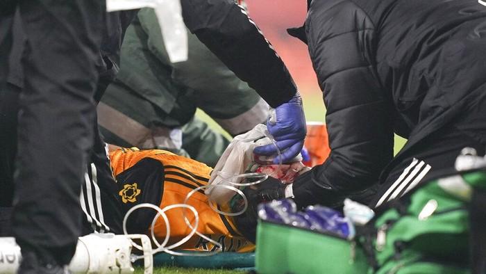 Wolverhampton Wanderers Raul Jimenez receives treatment from medical staff following a head clash with Arsenals David Luiz during the English Premier League soccer match between Arsenal and Wolverhampton Wanderers at Emirates Stadium, London, Sunday, Nov. 29, 2020. (John Walton/Pool via AP)