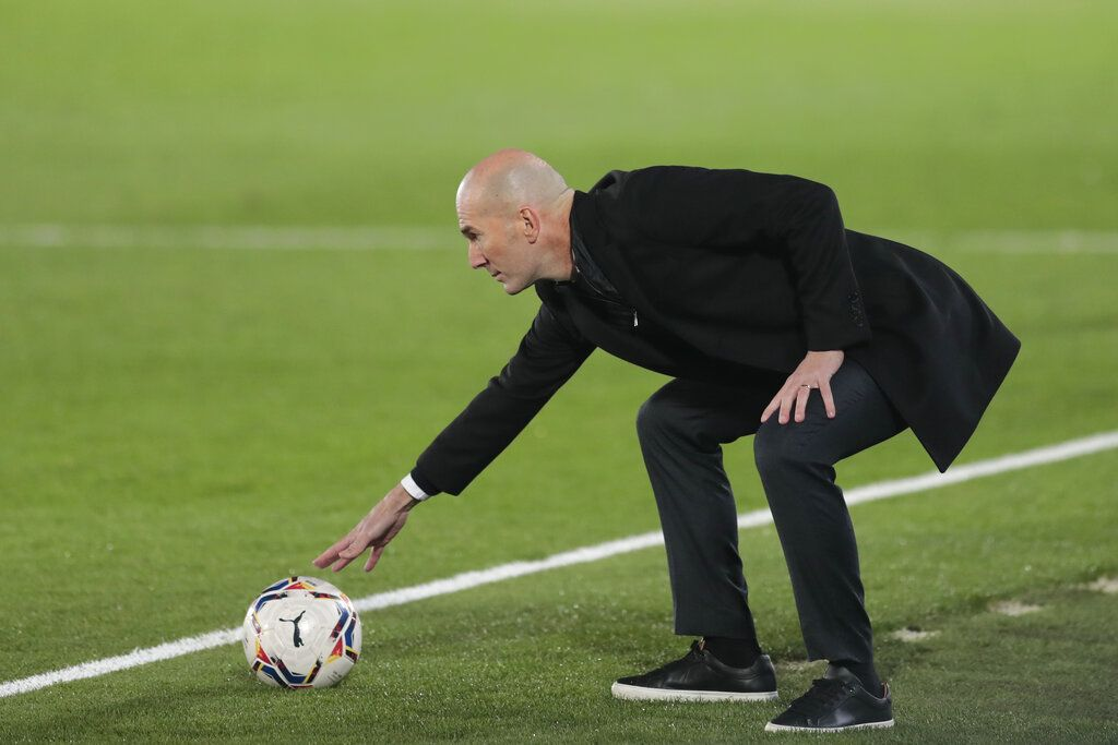 Real Madrid's head coach Zinedine Zidane touches a ball during the Spanish La Liga soccer match between Real Madrid and Alaves at Alfredo di Stefano stadium in Madrid, Spain, Saturday, Nov. 28, 2020. (AP Photo/Bernat Armangue)