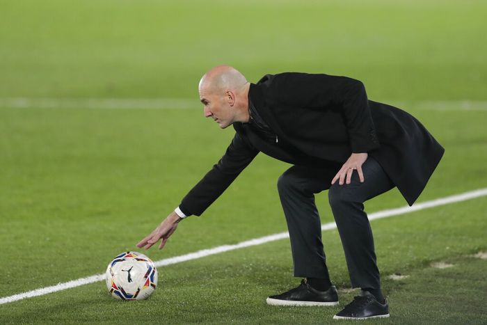 Real Madrids head coach Zinedine Zidane touches a ball during the Spanish La Liga soccer match between Real Madrid and Alaves at Alfredo di Stefano stadium in Madrid, Spain, Saturday, Nov. 28, 2020. (AP Photo/Bernat Armangue)