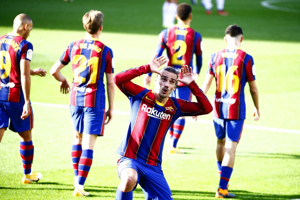 Barcelona's Antoine Griezmann celebrates after scoring his side's second goal during the Spanish La Liga soccer match between FC Barcelona and Osasuna at the Camp Nou stadium in Barcelona, Spain, Sunday, Nov. 29, 2020. (AP Photo/Joan Monfort)