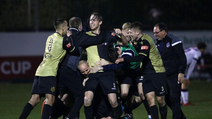 CROSBY, ENGLAND - NOVEMBER 29: Marine players celebrate winning the match after the final whistle during the Emirates FA Cup Second Round match between Marine FC and Havant and Waterloovile at The Marine Travel Arena on November 29, 2020 in Crosby, England. Sporting stadiums around the UK remain under strict restrictions due to the Coronavirus Pandemic as Government social distancing laws prohibit fans inside venues resulting in games being played behind closed doors. (Photo by Jan Kruger/Getty Images)