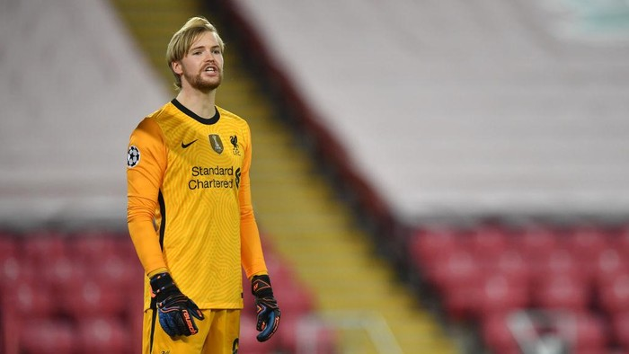LIVERPOOL, ENGLAND - DECEMBER 01: Caoimhin Kelleher of Liverpool reacts during the UEFA Champions League Group D stage match between Liverpool FC and Ajax Amsterdam at Anfield on December 01, 2020 in Liverpool, England. Sporting stadiums around the UK remain under strict restrictions due to the Coronavirus Pandemic as Government social distancing laws prohibit fans inside venues resulting in games being played behind closed doors. (Photo by Paul Ellis - Pool/Getty Images)