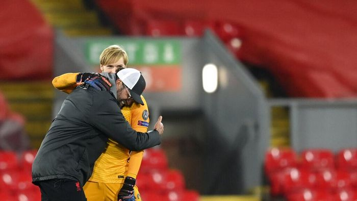 Liverpools manager Jurgen Klopp, left, celebrates with Liverpools goalkeeper Caoimhin Kelleher at the end of the Champions League group D soccer match between Liverpool and Ajax at Anfield stadium in Liverpool, England, Tuesday, Dec. 1, 2020. (Michael Regan/Pool via AP)