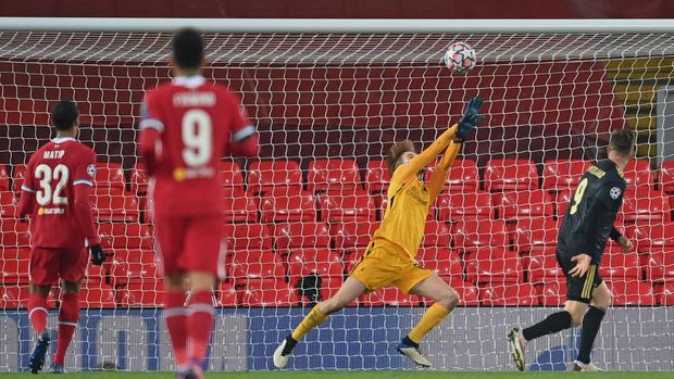LIVERPOOL, ENGLAND - DECEMBER 01: Caoimhin Kelleher of Liverpool saves from Klaas Jan Huntelaar of Ajax during the UEFA Champions League Group D stage match between Liverpool FC and Ajax Amsterdam at Anfield on December 01, 2020 in Liverpool, England. Sporting stadiums around the UK remain under strict restrictions due to the Coronavirus Pandemic as Government social distancing laws prohibit fans inside venues resulting in games being played behind closed doors. (Photo by Michael Regan/Getty Images)