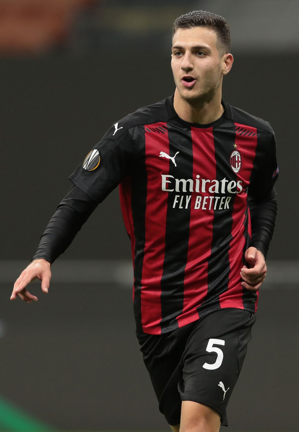 MILAN, ITALY - OCTOBER 29:  Diogo Dalot of AC Milan celebrates scoring his team's third goal during the UEFA Europa League Group H stage match between AC Milan and AC Sparta Praha at San Siro Stadium on October 29, 2020 in Milan, Italy. (Photo by Emilio Andreoli/Getty Images)