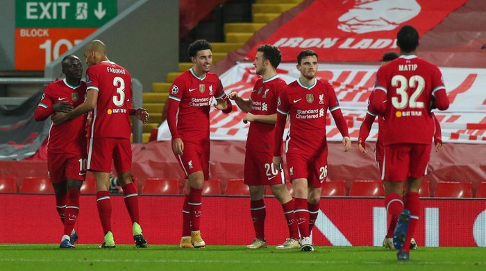 LIVERPOOL, ENGLAND - DECEMBER 01: Curtis Jones of Liverpool celebrates with Diogo Jota after scoring their teams first goal during the UEFA Champions League Group D stage match between Liverpool FC and Ajax Amsterdam at Anfield on December 01, 2020 in Liverpool, England. Sporting stadiums around the UK remain under strict restrictions due to the Coronavirus Pandemic as Government social distancing laws prohibit fans inside venues resulting in games being played behind closed doors. (Photo by Peter Byrne - Pool/Getty Images)