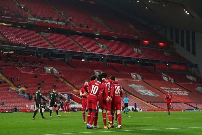 LIVERPOOL, ENGLAND - DECEMBER 01: General view inside the stadium as Curtis Jones of Liverpool celebrates with Sadio Mane and Andrew Robertson after scoring their teams first goal during the UEFA Champions League Group D stage match between Liverpool FC and Ajax Amsterdam at Anfield on December 01, 2020 in Liverpool, England. Sporting stadiums around the UK remain under strict restrictions due to the Coronavirus Pandemic as Government social distancing laws prohibit fans inside venues resulting in games being played behind closed doors. (Photo by Paul Ellis - Pool/Getty Images)