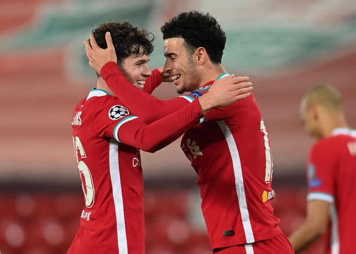 LIVERPOOL, ENGLAND - DECEMBER 01: Curtis Jones of Liverpool celebrates with teammate Neco Williams after scoring his teams first goal during the UEFA Champions League Group D stage match between Liverpool FC and Ajax Amsterdam at Anfield on December 01, 2020 in Liverpool, England. Sporting stadiums around the UK remain under strict restrictions due to the Coronavirus Pandemic as Government social distancing laws prohibit fans inside venues resulting in games being played behind closed doors. (Photo by Michael Regan/Getty Images)