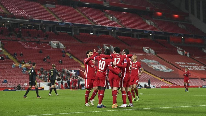 Liverpool players celebrate scoring their sides first goal during the Champions League group D soccer match between Liverpool and Ajax at Anfield stadium in Liverpool, England, Tuesday, Dec. 1, 2020. (Paul Ellis/Pool via AP)