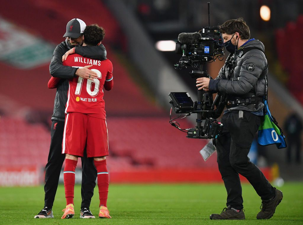 LIVERPOOL, ENGLAND - DECEMBER 01: Curtis Jones of Liverpool celebrates with teammate Neco Williams after scoring his team's first goal during the UEFA Champions League Group D stage match between Liverpool FC and Ajax Amsterdam at Anfield on December 01, 2020 in Liverpool, England. Sporting stadiums around the UK remain under strict restrictions due to the Coronavirus Pandemic as Government social distancing laws prohibit fans inside venues resulting in games being played behind closed doors. (Photo by Michael Regan/Getty Images)