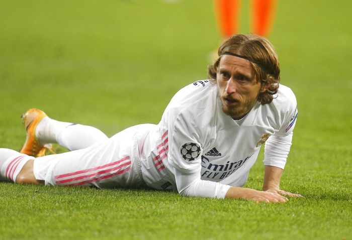 Real Madrids Luka Modric reacts during the Champions League, Group B, soccer match between Shakhtar Donetsk and Real Madrid at the Olimpiyskiy Stadium in Kyiv, Ukraine, Tuesday, Dec. 1, 2020. (AP Photo/Efrem Lukatsky)