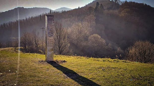A metal structure sticks from the ground on the Batca Doamnei hill, outside Piatra Neamt, northern Romania, on Nov. 27, 2020. The structure, similar in shape and size to the monolith that was placed in the Utah desert, has since disappeared.(Robert Iosub/ziarpiatraneamt.ro via AP)