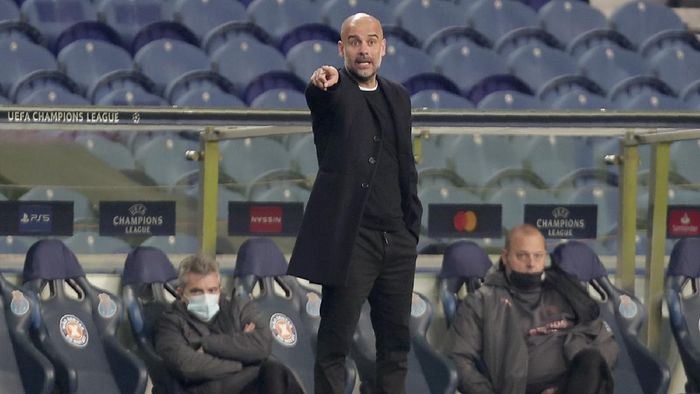 Manchester Citys head coach Pep Guardiola gestures during the Champions League group C soccer match between FC Porto and Manchester City at the Dragao stadium in Porto, Portugal, Tuesday, Dec. 1, 2020. (AP Photo/Luis Vieira)