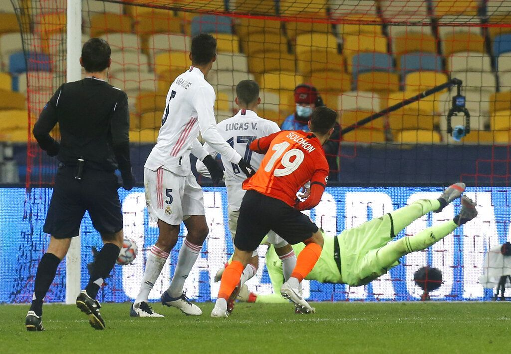 Shakhtar's Manor Solomon, front, scores his side's second goal during the Champions League, Group B, soccer match between Shakhtar Donetsk and Real Madrid at the Olimpiyskiy Stadium in Kyiv, Ukraine, Tuesday, Dec. 1, 2020. (AP Photo/Efrem Lukatsky)