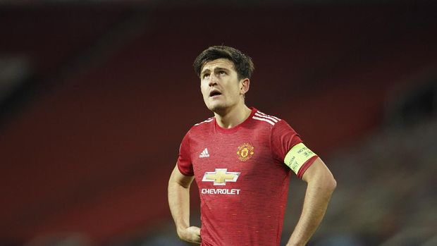 Manchester United's Harry Maguire reacts during a Group H Champions League soccer match between Manchester United and Paris Saint Germain at the Old Trafford stadium in Manchester, England, Wednesday, Dec. 2, 2020. (AP Photo/Dave Thompson)