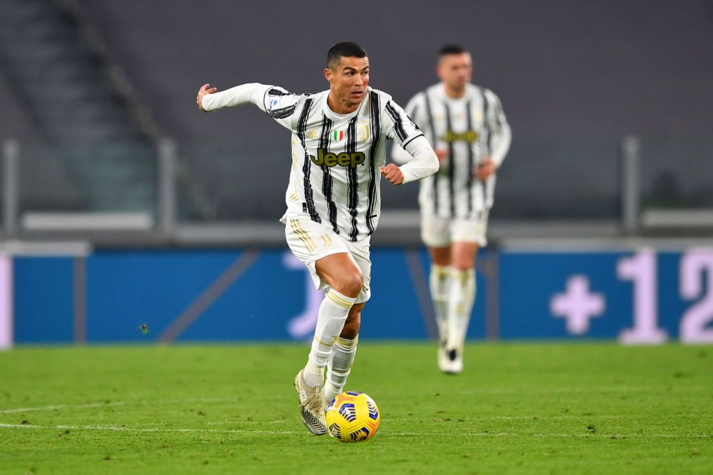 TURIN, ITALY - NOVEMBER 21: Cristiano Ronaldo of Juventus runs with the ball during the Serie A match between Juventus and Cagliari Calcio at  on November 21, 2020 in Turin, Italy. Football Stadiums around Europe remain empty due to the Coronavirus Pandemic as Government social distancing laws prohibit fans inside venues resulting in fixtures being played behind closed doors. (Photo by Valerio Pennicino/Getty Images)