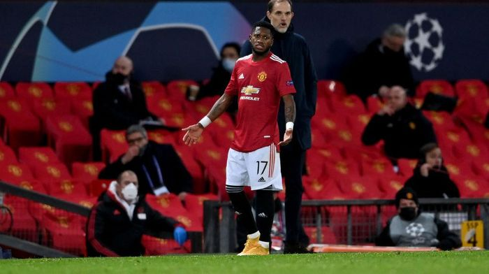 MANCHESTER, ENGLAND - DECEMBER 02: Fred of Manchester United gestures from the edge of the pitch after being sent off during the UEFA Champions League Group H stage match between Manchester United and Paris Saint-Germain at Old Trafford on December 02, 2020 in Manchester, England. Sporting stadiums around the UK remain under strict restrictions due to the Coronavirus Pandemic as Government social distancing laws prohibit fans inside venues resulting in games being played behind closed doors. (Photo by Laurence Griffiths/Getty Images)