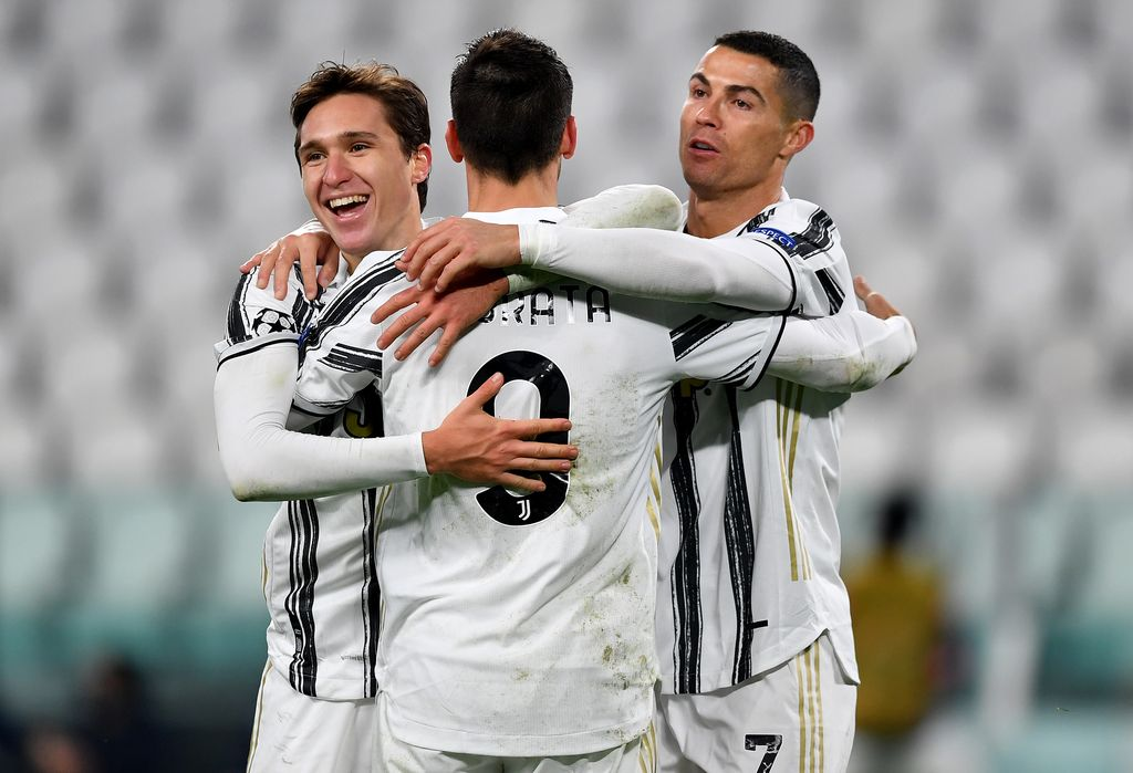 TURIN, ITALY - DECEMBER 02: Alvaro Morata of Juventus(C) celebrates after scoring their sides third goal with Federico Chiesa of Juventus(L) and Cristiano Ronaldo of Juventus(R) during the UEFA Champions League Group G stage match between Juventus and Dynamo Kyiv at Allianz Stadium on December 02, 2020 in Turin, Italy. Sporting stadiums around Italy remain under strict restrictions due to the Coronavirus Pandemic as Government social distancing laws prohibit fans inside venues resulting in games being played behind closed doors. (Photo by Valerio Pennicino/Getty Images)