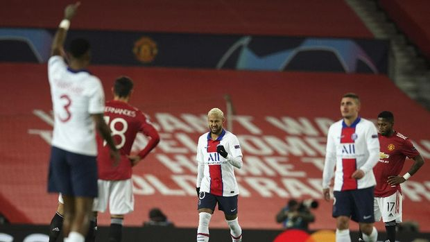 PSG's Neymar, center, celebrates after scoring the opening goal during a Group H Champions League soccer match between Manchester United and Paris Saint Germain at the Old Trafford stadium in Manchester, England, Wednesday, Dec. 2, 2020. (AP Photo/Dave Thompson)