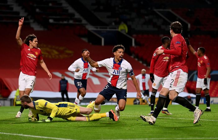 MANCHESTER, ENGLAND - DECEMBER 02: Marquinhos of Paris Saint-Germain celebrates after scoring their sides second goal during the UEFA Champions League Group H stage match between Manchester United and Paris Saint-Germain at Old Trafford on December 02, 2020 in Manchester, England. Sporting stadiums around the UK remain under strict restrictions due to the Coronavirus Pandemic as Government social distancing laws prohibit fans inside venues resulting in games being played behind closed doors. (Photo by Laurence Griffiths/Getty Images)