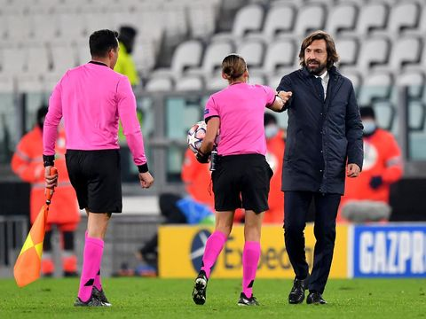 TURIN, ITALY - DECEMBER 02: Match Referee Stephanie Frappart(2R) and Andrea Pirlo, Head Coach of Juventus embrace at the final whistle during the UEFA Champions League Group G stage match between Juventus and Dynamo Kyiv at Allianz Stadium on December 02, 2020 in Turin, Italy. Sporting stadiums around Italy remain under strict restrictions due to the Coronavirus Pandemic as Government social distancing laws prohibit fans inside venues resulting in games being played behind closed doors. (Photo by Valerio Pennicino/Getty Images)