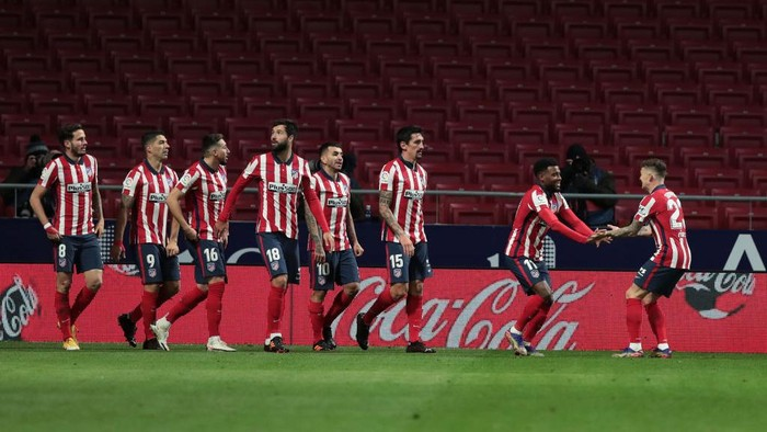 MADRID, SPAIN - DECEMBER 05: Thomas Lemar of Atletico de Madrid celebrates scoring his sides first goal during the La Liga Santander match between Atletico de Madrid and Real Valladolid CF at Estadio Wanda Metropolitano on December 05, 2020 in Madrid, Spain. Football Stadiums around Spain remain empty due to the Coronavirus Pandemic as Government social distancing laws prohibit fans inside venues resulting in fixtures being played behind closed doors. (Photo by Gonzalo Arroyo Moreno/Getty Images)