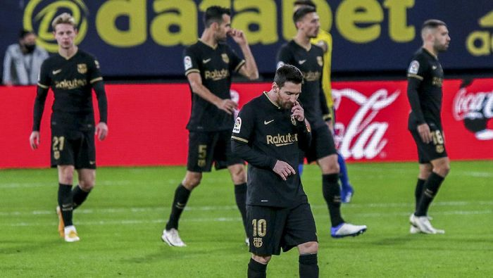 Barcelonas Lionel Messi reacts after Cadiz scored a goal during the Spanish La Liga soccer match between Cadiz and FC Barcelona at the Ramon Carranza stadium in Cadiz, Spain, Saturday Dec. 5, 2020. (AP Photo/Alvaro Rivero)