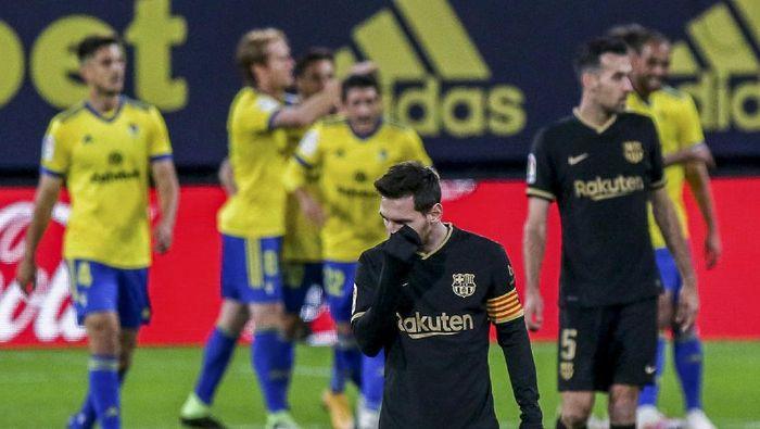 Barcelonas Lionel Messi reacts after Cadiz scored a goal during the Spanish La Liga soccer match between Cadiz and FC Barcelona at the Ramon Carranza stadium in Cadiz, Spain, Saturday Dec. 5, 2020. (AP Photo/Alvaro Rivero)