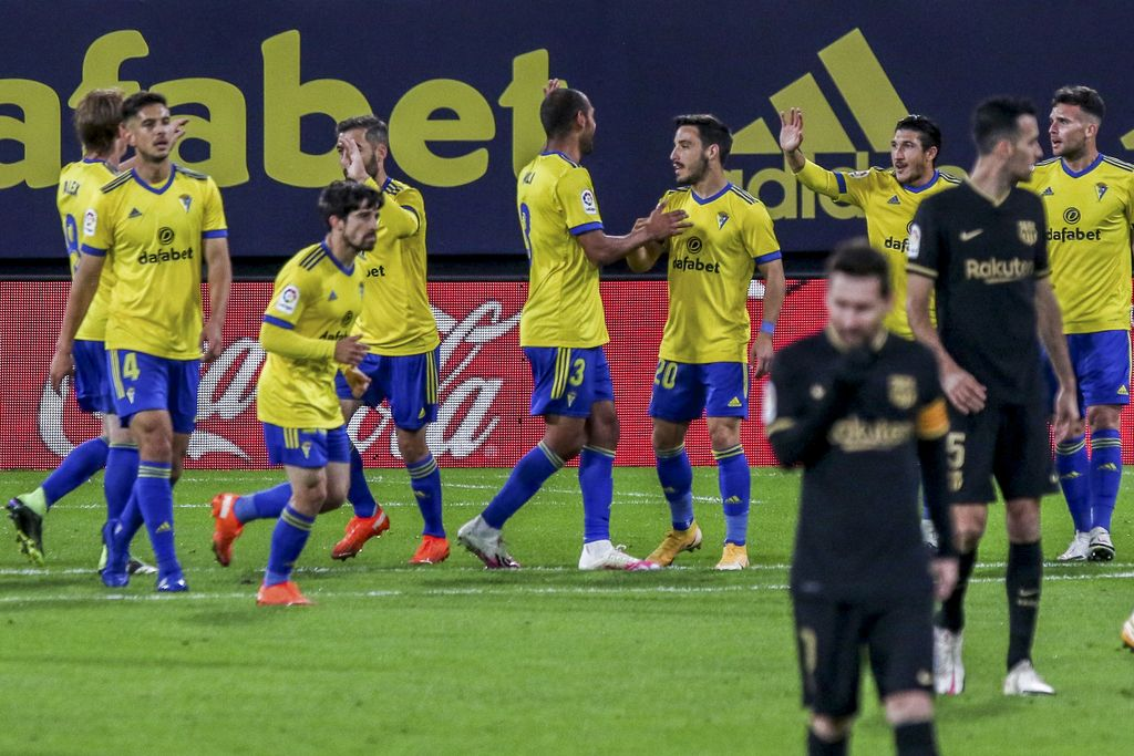 Cadiz players celebrate their opening goal during the Spanish La Liga soccer match between Cadiz and FC Barcelona at the Ramon Carranza stadium in Cadiz, Spain, Saturday Dec. 5, 2020. (AP Photo/Alvaro Rivero)