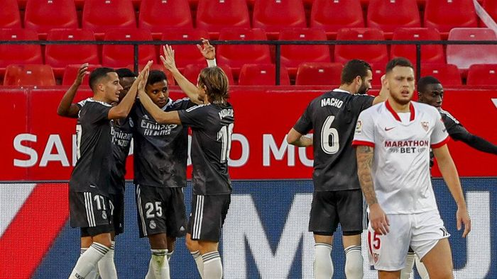 Real Madrids players celebrate a goal during the Spanish La Liga soccer match between Sevilla and Real Madrid at the Ramon Sanchez Pizjuan stadium in Seville, Spain, Saturday Dec. 5, 2020. (AP Photo/Angel Fernandez)