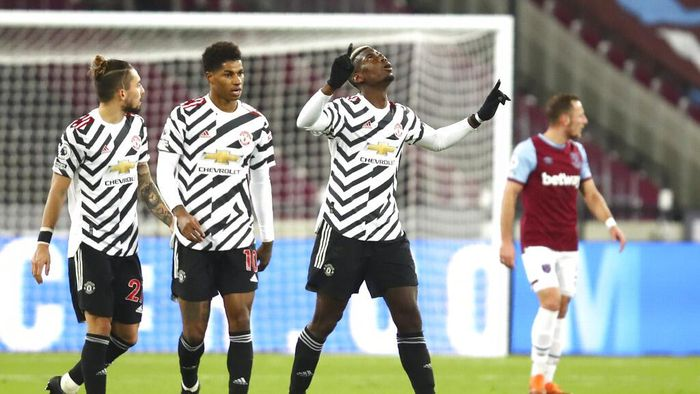 Manchester Uniteds Paul Pogba celebrates after scoring his sides opening goal during the English Premier League soccer match between West Ham United and Manchester United at the London stadium in London, England, Saturday, Dec. 5, 2020. (Julian Finney/Pool Via AP)