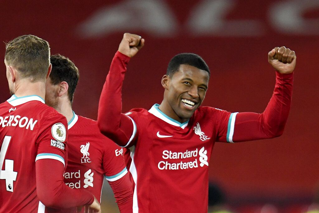 Liverpool's Georginio Wijnaldum celebrates after scoring his side's second goal during the English Premier League soccer match between Liverpool and Wolverhampton Wanderers at Anfield Stadium, Liverpool, England, Sunday, Dec. 6, 2020. (Peter Powell/Pool via AP)