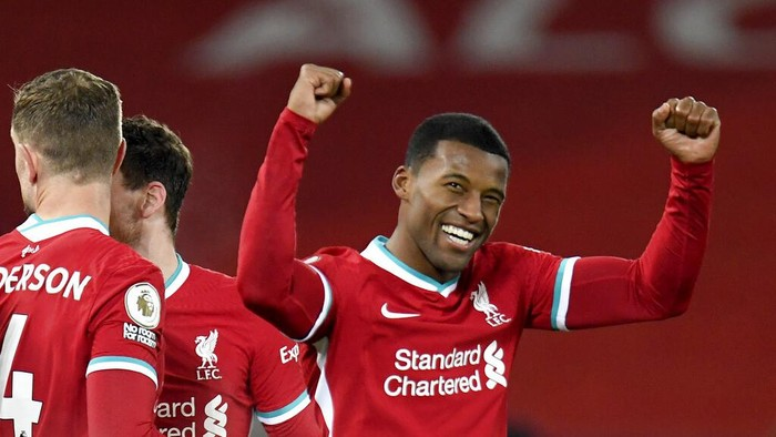 Liverpools Georginio Wijnaldum celebrates after scoring his sides second goal during the English Premier League soccer match between Liverpool and Wolverhampton Wanderers at Anfield Stadium, Liverpool, England, Sunday, Dec. 6, 2020. (Peter Powell/Pool via AP)