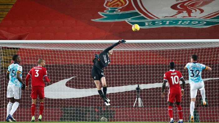 LIVERPOOL, ENGLAND - DECEMBER 06: Caoimhin Kelleher of Liverpool makes a save during the Premier League match between Liverpool and Wolverhampton Wanderers at Anfield on December 06, 2020 in Liverpool, England. A limited number of fans (2000) are welcomed back to stadiums to watch elite football across England. This was following easing of restrictions on spectators in tiers one and two areas only. (Photo by Clive Brunskill/Getty Images)