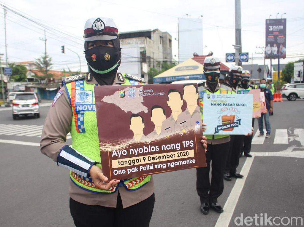 Begini Cara Polisi Ajak Warga Sidoarjo Datang ke TPS pada 9 Desember