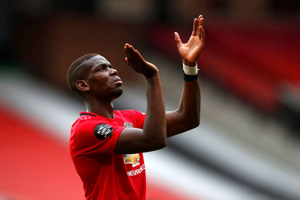 MANCHESTER, ENGLAND - JULY 04: Paul Pogba of Manchester United reacts during the Premier League match between Manchester United and AFC Bournemouth  at Old Trafford on July 04, 2020 in Manchester, England. Football Stadiums around Europe remain empty due to the Coronavirus Pandemic as Government social distancing laws prohibit fans inside venues resulting in all fixtures being played behind closed doors. (Photo by Clive Brunskill/Getty Images)