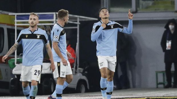 Lazio's Joaquin Correa celebrates after scoring his side's opening goal during the Champions League, group F soccer match between Lazio and Club Brugge, at the Rome Olympic Stadium, Tuesday, Dec. 8, 2020. (AP Photo/Andrew Medichini)