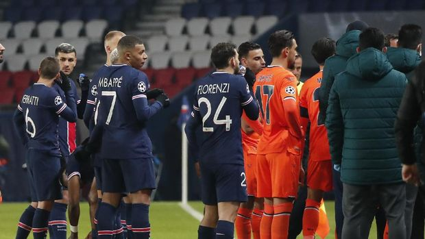 Players of Paris Saint Germain, and Istanbul Basaksehir leave the pitch, during the Champions League group H soccer match between Paris Saint Germain and Istanbul Basaksehir at the Parc des Princes stadium in Paris, Tuesday Dec. 8 , 2020. Basaksehir's assistant coach Pierre Webo was shown a straight red card in the 16th minute before the players refused to continue the match amid allegations of racism by one of the match officials. (AP Photo/Francois Mori)