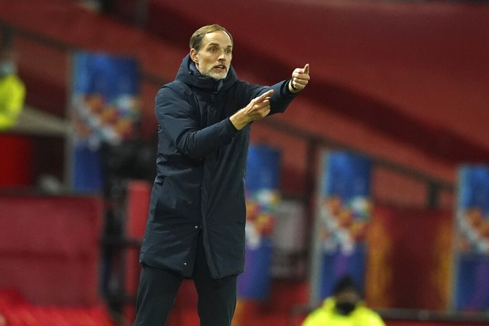 PSGs head coach Thomas Tuchel signals during a Group H Champions League soccer match between Manchester United and Paris Saint Germain at the Old Trafford stadium in Manchester, England, Wednesday, Dec. 2, 2020. (AP Photo/Dave Thompson)