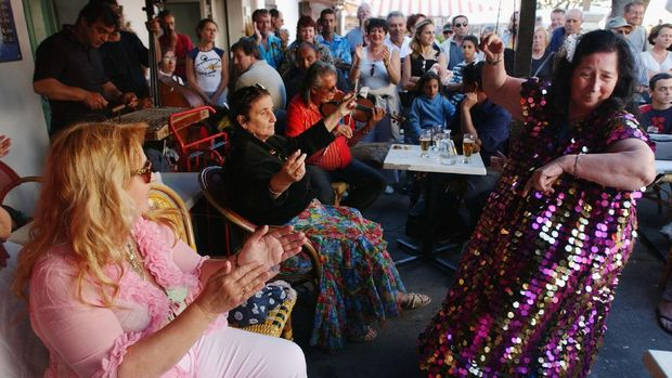 SAINTES MARIES DE LA MER, FRANCE - MAY 25: Gypsies dance in a cafe in Saintes Maries de la Mer in the Camargue region of Southern France on May 25, 2004. The annual pilgrimage is observed by Rroma from all over the world, but especially the Gitans, Rroma, Sinti, and Manouches of France. Their purpose is to pay respect to Sara-la-Kali, or Sara the Black. (Photo by Marco Di Lauro/Getty Images)