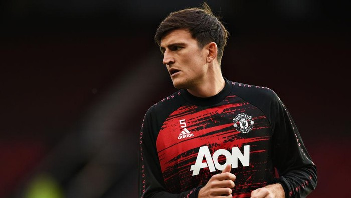 MANCHESTER, ENGLAND - OCTOBER 04: Harry Maguire of Manchester United warms up ahead of the Premier League match between Manchester United and Tottenham Hotspur at Old Trafford on October 04, 2020 in Manchester, England. Sporting stadiums around the UK remain under strict restrictions due to the Coronavirus Pandemic as Government social distancing laws prohibit fans inside venues resulting in games being played behind closed doors. (Photo by Oli Scarff - Pool/Getty Images)