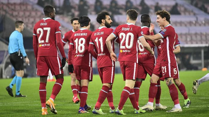 Liverpool players celebrate the first goal of the game against Midtjylland, during their Champions League Group D soccer match at MCH Arena in Herning, Denmark, Wednesday Dec. 9, 2020. (Bo Amstrup/Scanpix via AP)