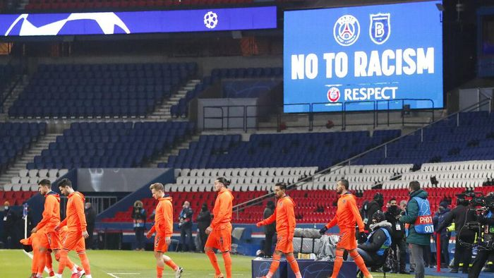 Basaksehir players arrive on the pitch before the start of the Champions League group H soccer match between Paris Saint Germain and Istanbul Basaksehir at the Parc des Princes stadium in Paris, France, Wednesday, Dec. 9, 2020. The match is resuming on Wednesday with a new refereeing team after players from Paris Saint-Germain and Istanbul Basaksehir left the field on Tuesday evening and didnt return when the fourth official — Sebastian Coltescu of Romania — was accused of using a racial term to identify Basaksehir assistant coach Pierre Webo before sending him off for his conduct on the sidelines. (AP Photo/Francois Mori)