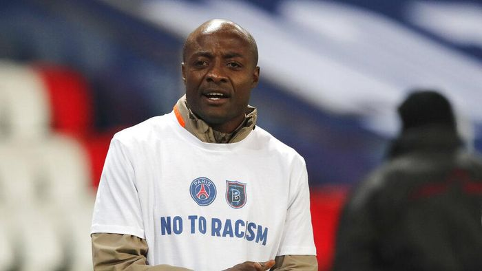 Basaksehir assistant coach Pierre Webo prior to the Champions League group H soccer match between Paris Saint Germain and Istanbul Basaksehir at the Parc des Princes stadium in Paris, France, Wednesday, Dec. 9, 2020. The match is resuming on Wednesday with a new refereeing team after players from Paris Saint-Germain and Istanbul Basaksehir left the field on Tuesday evening and didn't return when the fourth official — Sebastian Coltescu of Romania — was accused of using a racial term to identify Basaksehir assistant coach Pierre Webo before sending him off for his conduct on the sidelines.  (AP Photo/Francois Mori)